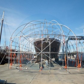 Temporary shelters for on site maintenance, repairs or construction under scaffolding