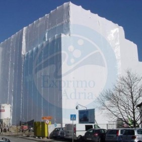 Scaffolding covering of big building with shrink wrap